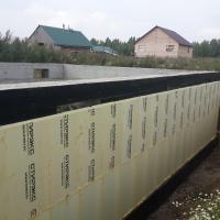 Работы по гидроизоляции и утеплению цокольного этажа частного дома в коттеджном поселке